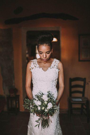 Elegant Bride in Pre Owned Lace Wedding Dress