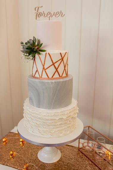 Elegant Wedding Cake With Grey & Gold Icing