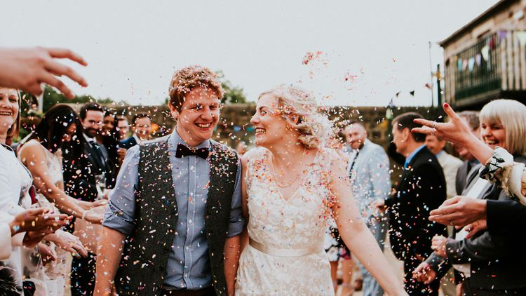 Confetti Moment   Bride in Catherine Deane Gown   Groom in Ben Sherman Suit, Bow Tie & Gingham Shirt   Colourful Barn Reception at Lineham Farm in Leeds   Shutter Go Click Photography