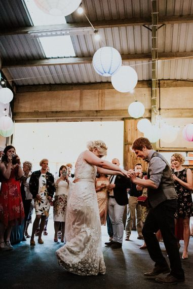 First Dance   Bride in Catherine Deane Gown   Groom in Ben Sherman Suit, Bow Tie & Gingham Shirt   Colourful Barn Reception at Lineham Farm in Leeds   Shutter Go Click Photography