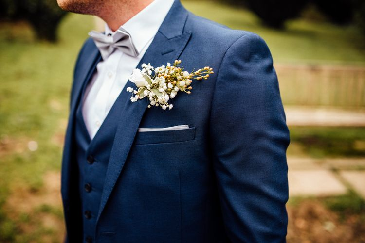 Buttonhole | Groom in Blue Moss Bros Suit | Michelle Wood Photography