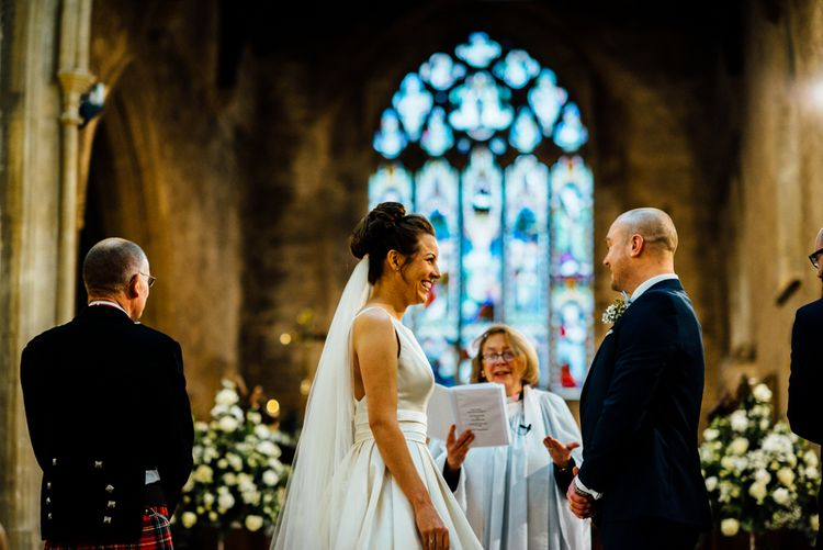 Church Wedding Ceremony | Bride in Pronovias Tami Wedding Dress | Groom in Blue Moss Bros Suit | Michelle Wood Photography
