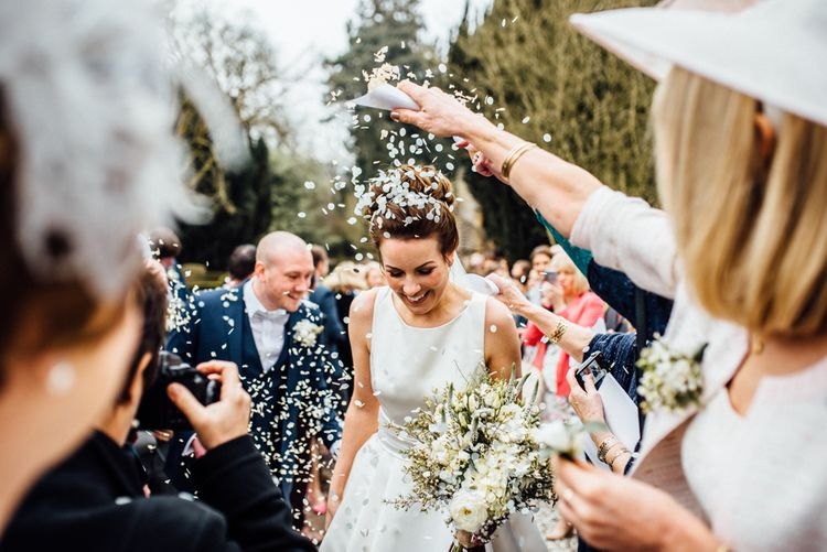 Confetti Exit | Bride in Pronovias Tami Wedding Dress | Groom in Blue Moss Bros Suit | Michelle Wood Photography