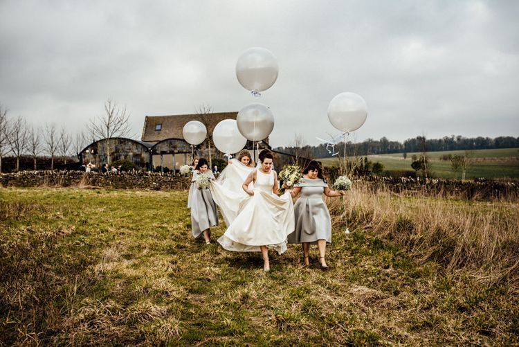 Giant Balloons | Bridesmaids in Grey ASOS High Low Bardot Dresses | Bride in Pronovias Tami Wedding Dress | Michelle Wood Photography