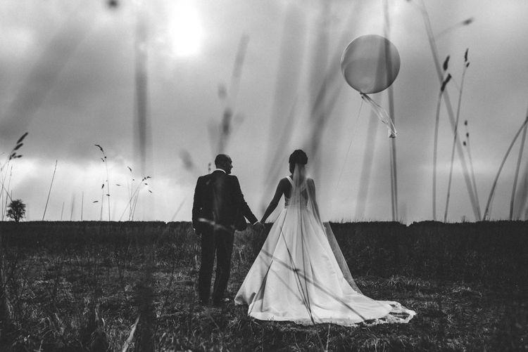 Giant Balloons | Bride in Pronovias Tami Wedding Dress | Groom in Blue Moss Bros Suit | Michelle Wood Photography