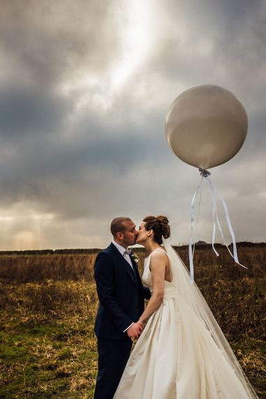 Giant Balloon | Bride in Pronovias Tami Wedding Dress | Groom in Blue Moss Bros Suit | Michelle Wood Photography