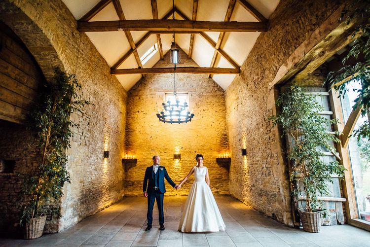 Bride in Pronovias Tami Wedding Dress | Groom in Blue Moss Bros Suit | Cripps Stone Barn Venue | Michelle Wood Photography