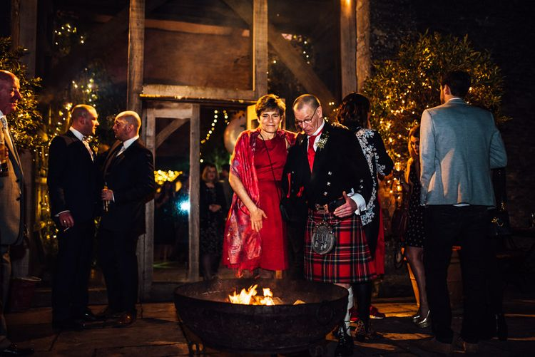 Fire Pit | Cripps Stone Barn | Groom in Blue Moss Bros Suit | Michelle Wood Photography