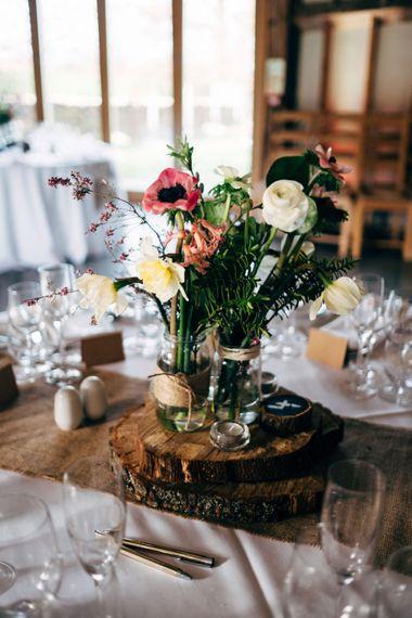 Rustic Tree Slice & Flowers in Jars Centrepiece | Dale Weeks Photography