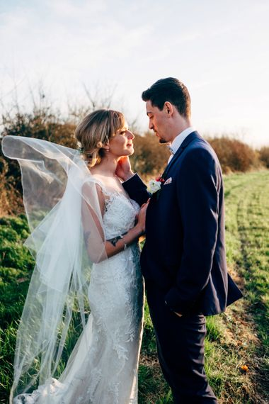 Bride in Lace Illusion Neck Wedding Dress | Groom in Next Suit | Dale Weeks Photography