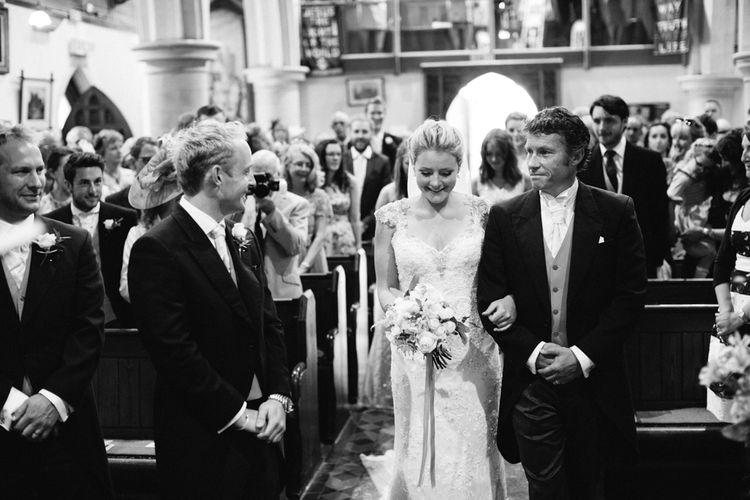 Bride in Maggie Sottero Wedding Dress Church Ceremony