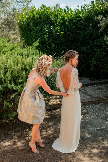 Bride in Love Back Atelier Endeavour Gown | Bridesmaid in Eliza J Brocade Dress | Destination Wedding at Pienza, Italy | Nordica Photography