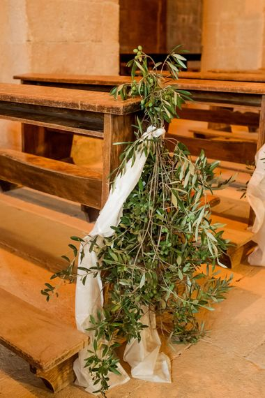 Olive Leave Pew End Wedding Decor | Destination Wedding at Pienza, Italy | Nordica Photography