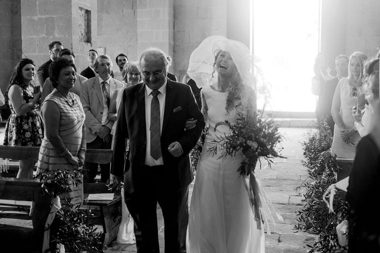 Wedding Ceremony | Bridal Entrance in Low Back Atelier Endeavour Gown | Destination Wedding at Pienza, Italy | Nordica Photography