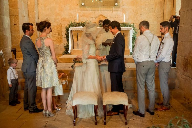 Wedding Ceremony | Bride in Low Back Atelier Endeavour Gown | Groom in Hugo Boss Suit | Destination Wedding at Pienza, Italy | Nordica Photography