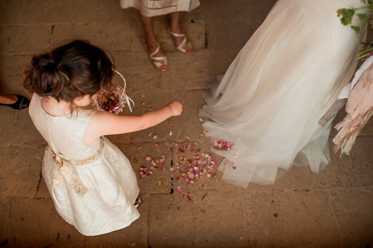 Flower Girl with Confetti | Destination Wedding at Pienza, Italy | Nordica Photography