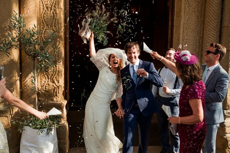 Confetti Exit | Bride in Low Back Atelier Endeavour Gown | Groom in Hugo Boss Suit | Destination Wedding at Pienza, Italy | Nordica Photography