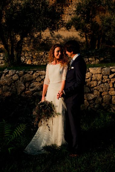 Bride in Low Back Atelier Endeavour Gown | Groom in Hugo Boss Suit | Destination Wedding at Pienza, Italy | Nordica Photography