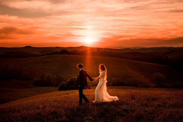 Golden Hour | Bride in Low Back Atelier Endeavour Gown | Groom in Hugo Boss Suit | Destination Wedding at Pienza, Italy | Nordica Photography