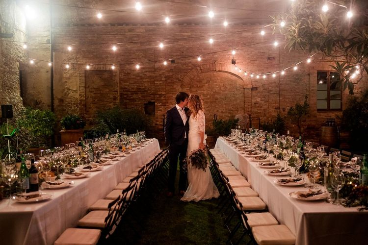 Festoon Light Reception | Bride in Low Back Atelier Endeavour Gown | Groom in Hugo Boss Suit | Destination Wedding at Pienza, Italy | Nordica Photography