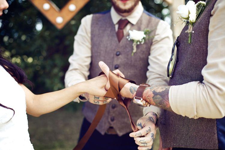 Hand FasteningOutdoor Wedding Ceremony at Wood Farm | Vintage Weddings Photography