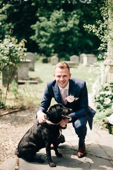 """Groom in Navy Reiss Suit 
