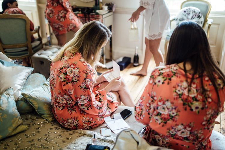 Bridesmaids Getting Ready In Floral Robes
