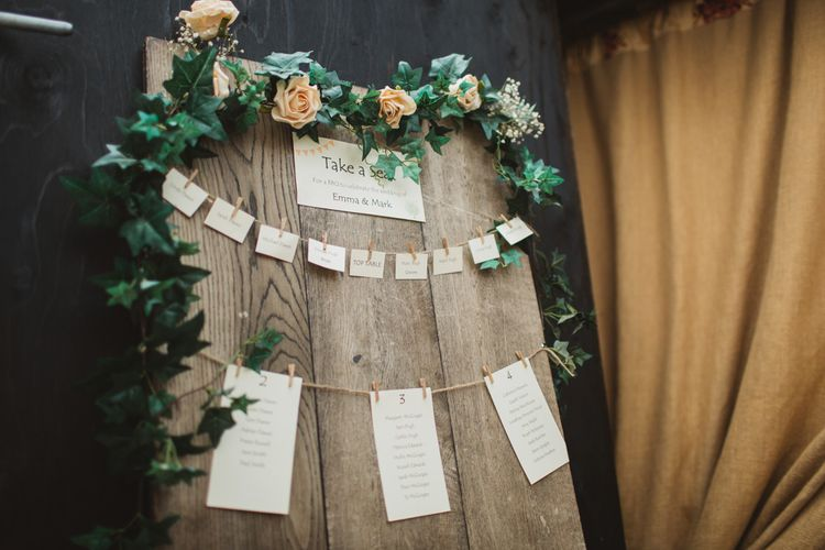 Rustic Wedding Table Plan Made From Wooden Planks