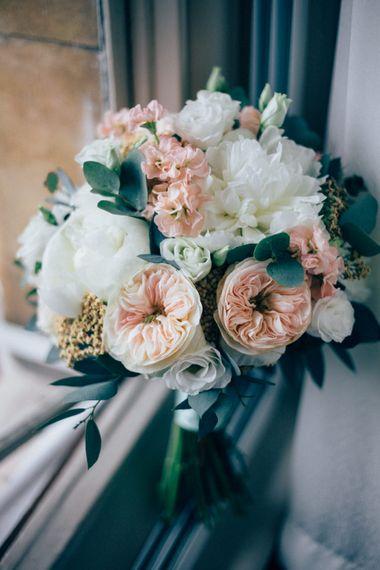 Romantic Peach & White Bridal Bouquet with David Austin Roses   Pastel Wedding at Parkside School in Surrey   Nikki van der Molen Photography   The Modern Revelry Film