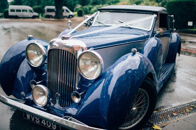 Vintage Wedding Car   Pastel Wedding at Parkside School in Surrey   Nikki van der Molen Photography   The Modern Revelry Film