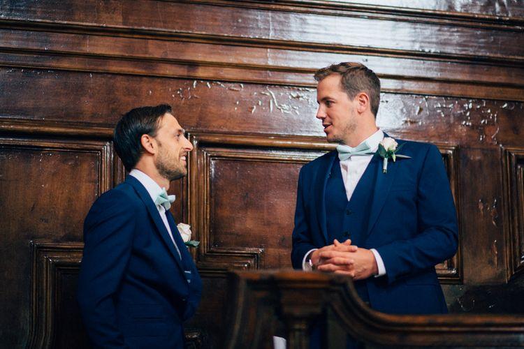 Groomsmen in Navy Blue French Connection Suits & Bow Ties   Pastel Wedding at Parkside School in Surrey   Nikki van der Molen Photography   The Modern Revelry Film
