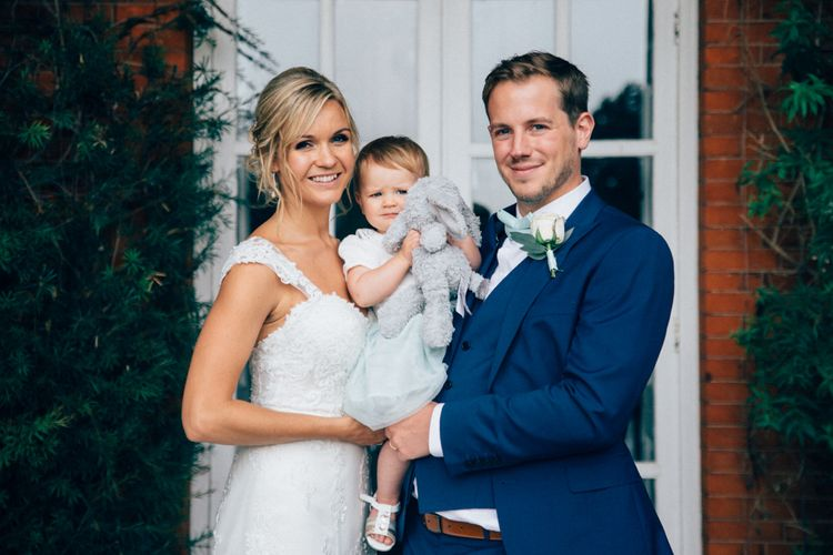 Family Portrait   Bride in Stella York Lace Gown   Groom in Navy French Connection Suit   Pastel Wedding at Parkside School in Surrey   Nikki van der Molen Photography   The Modern Revelry Film