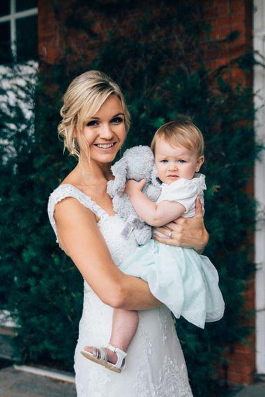 Bride & Baby Daughter   Lace Stella York Wedding Dress   Pastel Wedding at Parkside School in Surrey   Nikki van der Molen Photography   The Modern Revelry Film