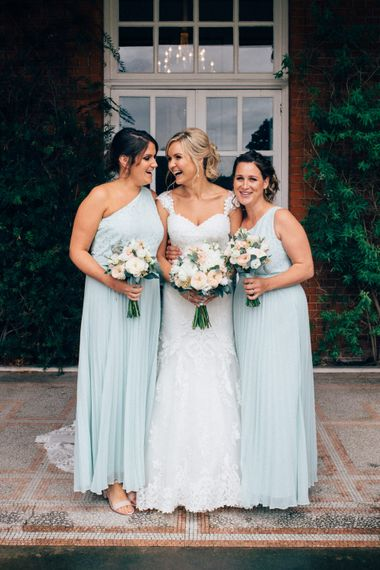 Bridesmaids in Mint Green Oasis Dresses   Bride in Stella York Lace Gown   Groom in Navy French Connection Suit   Pastel Wedding at Parkside School in Surrey   Nikki van der Molen Photography   The Modern Revelry Film