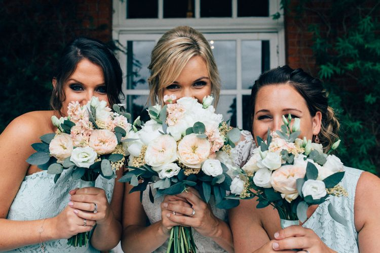 Romantic White & Peach Bouquets   Bridesmaids in Mint Green Oasis Dresses   Bride in Stella York Lace Gown   Groom in Navy French Connection Suit   Pastel Wedding at Parkside School in Surrey   Nikki van der Molen Photography   The Modern Revelry Film