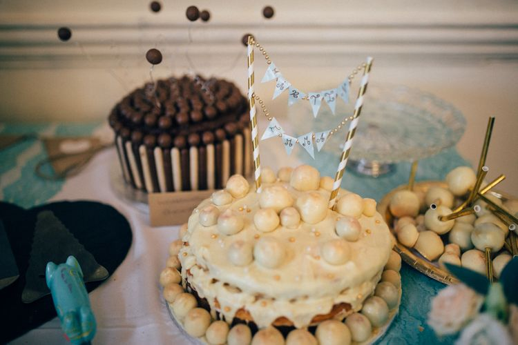 Bake Off Wedding Cake Table   Pastel Wedding at Parkside School in Surrey   Nikki van der Molen Photography   The Modern Revelry Film