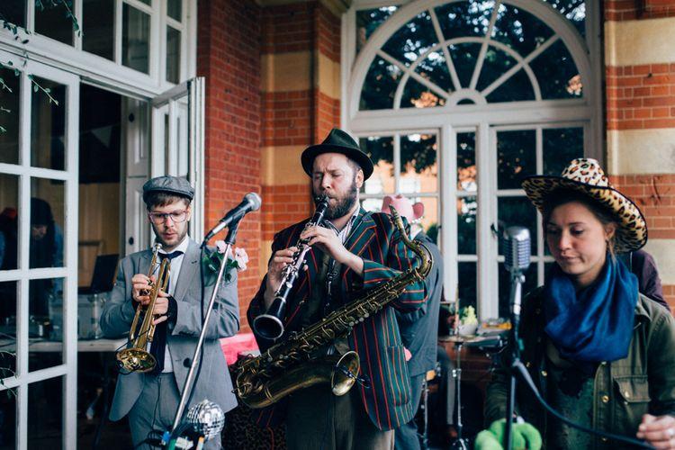Wedding Band   Pastel Wedding at Parkside School in Surrey   Nikki van der Molen Photography   The Modern Revelry Film