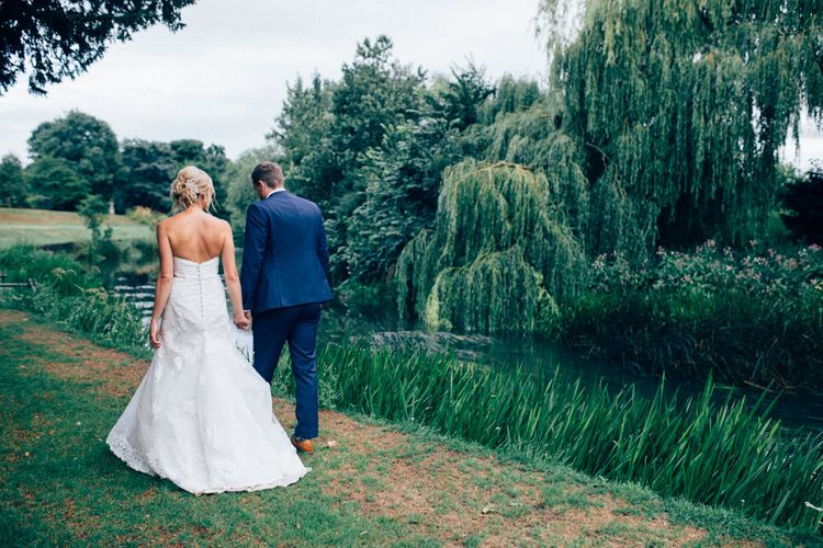 Bride in Stella York Lace Gown   Groom in Navy French Connection Suit   Pastel Wedding at Parkside School in Surrey   Nikki van der Molen Photography   The Modern Revelry Film