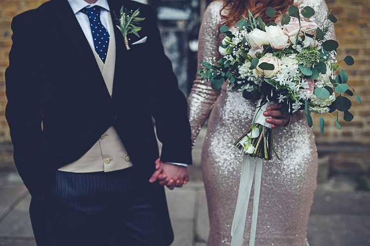 Bride In Gold Sequinned Dress For A Relaxed Wedding At Asylum Chapel With Bridesmaids In Mismatched High Street Dresses And Images by Lovestruck Photography