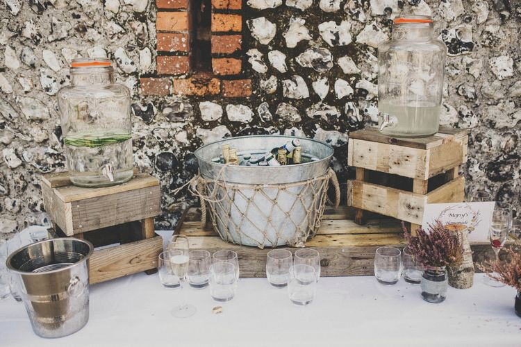 Drinks Dispensers on Wooden Crates