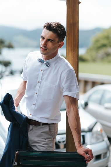 Groomsman in Chinos and Bow Tie | Outdoor Coastal Wedding at Ohawini Bay in New Zealand with Natural Garden Party Reception | Miss Gen Photography