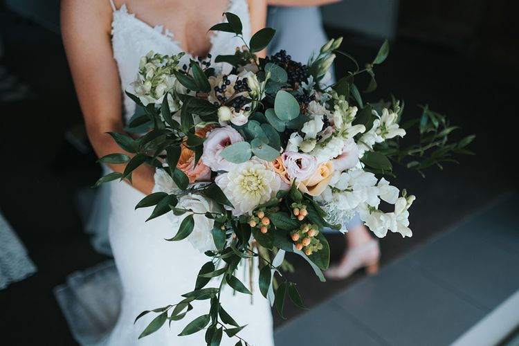 Over sized Bridal Bouquet with Blush Blooms & Foliage | Outdoor Coastal Wedding at Ohawini Bay in New Zealand with Natural Garden Party Reception | Miss Gen Photography