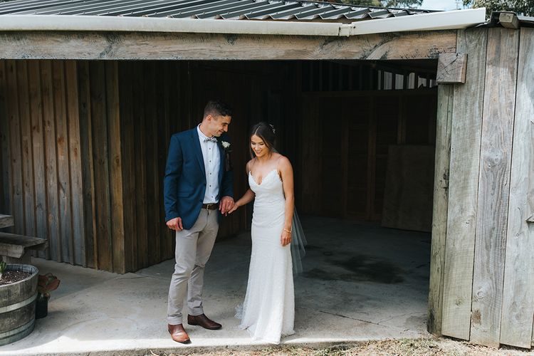 First Look | Bride in Sally Eagle 'Estelle' Gown | Groom in Chinos & Blazer | Outdoor Coastal Wedding at Ohawini Bay in New Zealand with Natural Garden Party Reception | Miss Gen Photography