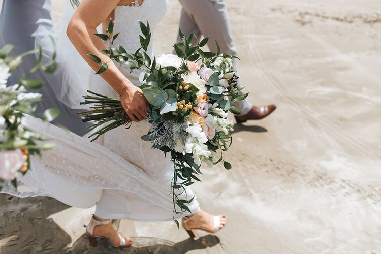 Bride in Sally Eagle 'Estelle' Gown | Andrea Biani Shoes | Outdoor Coastal Wedding at Ohawini Bay in New Zealand with Natural Garden Party Reception | Miss Gen Photography