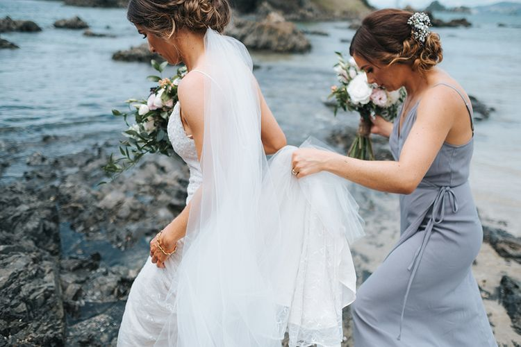 Bride in Estelle Sally Eagle Gown | Outdoor Coastal Wedding at Ohawini Bay in New Zealand with Natural Garden Party Reception | Miss Gen Photography