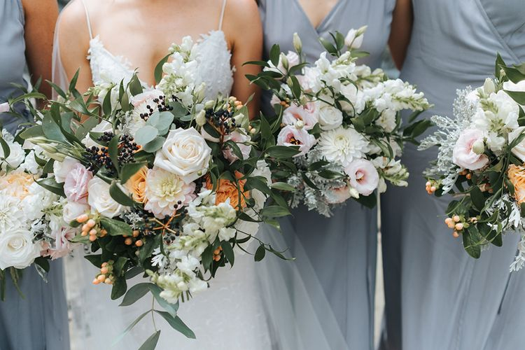 Romantic Bouquets | Bride in Estelle Sally Eagle Gown | Bridesmaids in Powder Blue Evolution Clothing Dresses | Outdoor Coastal Wedding at Ohawini Bay in New Zealand with Natural Garden Party Reception | Miss Gen Photography