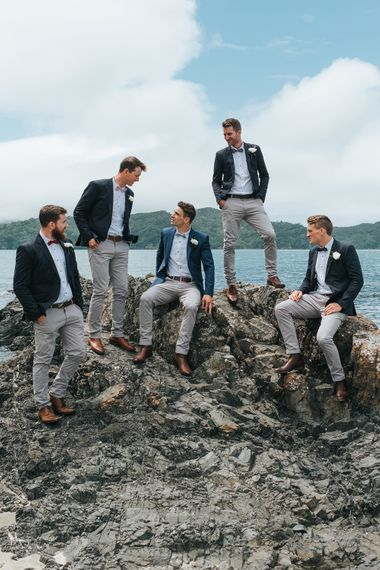 Groomsmen in Grey Chinos & Navy Blazers | Outdoor Coastal Wedding at Ohawini Bay in New Zealand with Natural Garden Party Reception | Miss Gen Photography