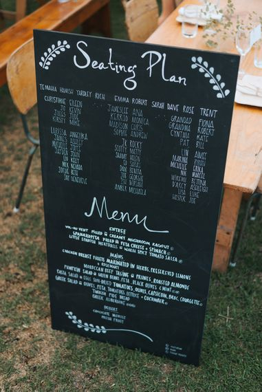 Chalkboard Wedding Sign | Outdoor Coastal Wedding at Ohawini Bay in New Zealand with Natural Garden Party Reception | Miss Gen Photography