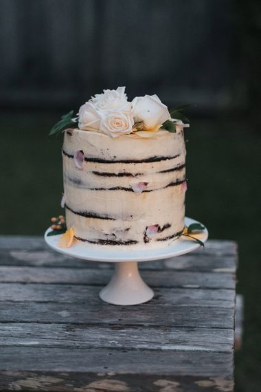 Homemade Cake | Marquee Reception with Wood, Greenery & Festoon Light Decor | Outdoor Coastal Wedding at Ohawini Bay in New Zealand with Natural Garden Party Reception | Miss Gen Photography