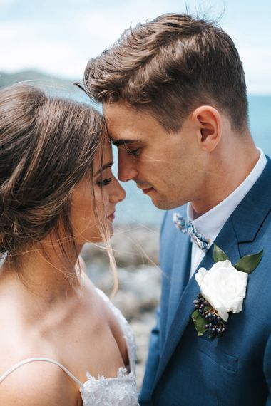 Bride in Estelle Sally Eagle Gown | Groom in Grey Chinos & Navy Blazer | Outdoor Coastal Wedding at Ohawini Bay in New Zealand with Natural Garden Party Reception | Miss Gen Photography